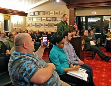 Second Amendment advocate Josh Finnical speaks during a Cumberland County freeholder meeting in support of a pro-gun rights resolution. (Emma Lee/WHYY)