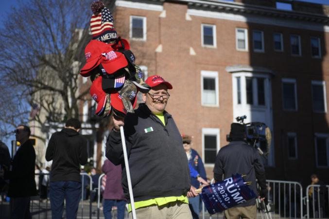 A street vendor hawks Trump merchandise ahead of a televised town hall in Scranton, Pa. on Thursday  (Bastiaan Slabbers for Keystone Crossroads)