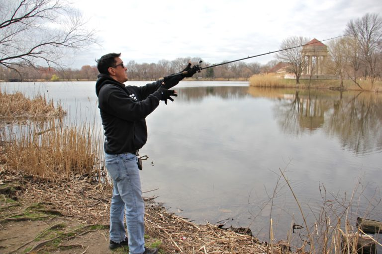 Tony Yoon fishes at Meadow Lake in FDR Park. (Emma Lee/WHYY)