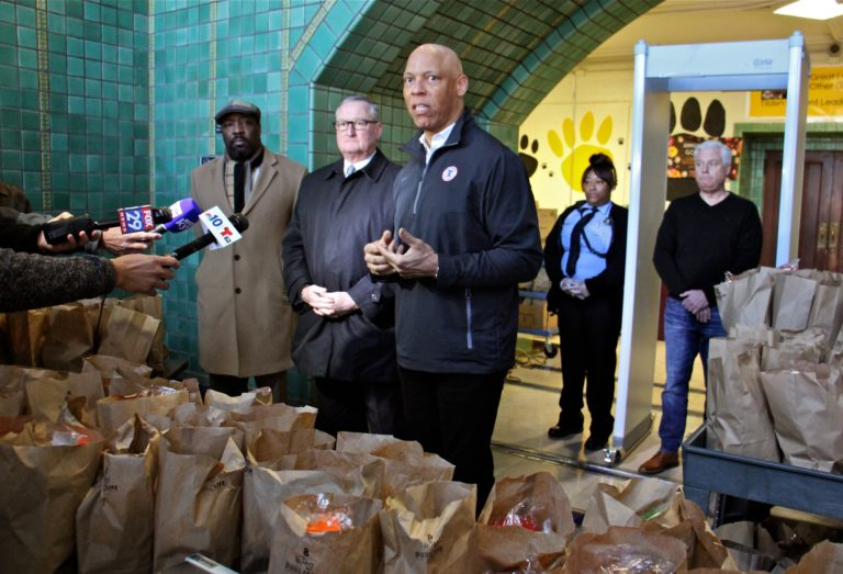 Philadelphia schools Superintendant William Hite (center) is joined by (from left) Councilman Kenyatta Johnson and Mayor Jim Kenney during a press conference at Tilden Middle School, where hundreds of bagged meals were prepared to meet the needs of students who depend on the schools for much of their food. (Emma Lee/WHYY)