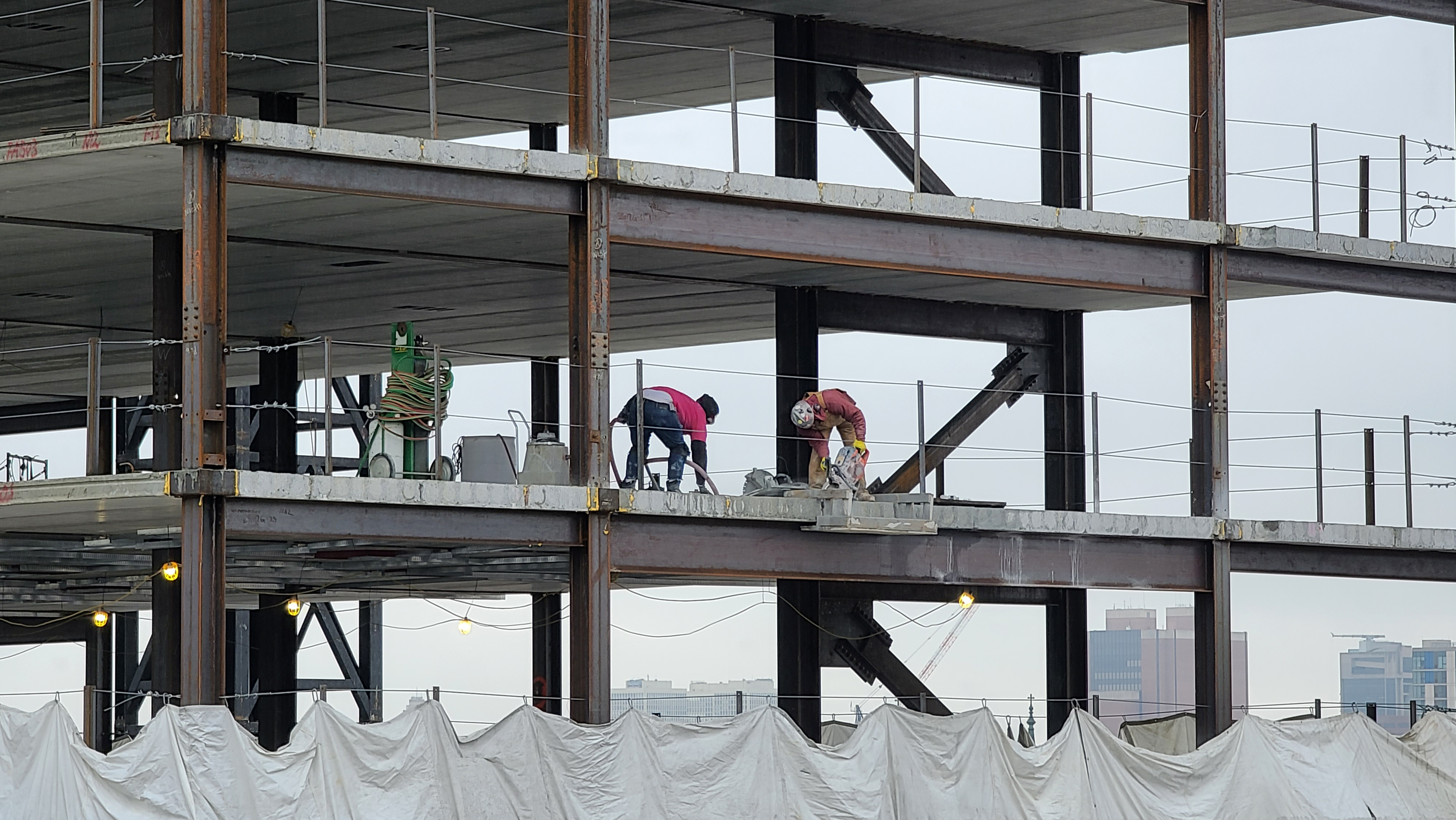 Workers on the 9th floor of the rising tower at 1300 Fairmount Ave.