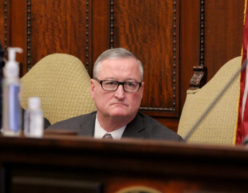 Philadelphia Mayor Jim Kenney listens during the daily coronavirus update at City Hall. (Emma Lee/WHYY)