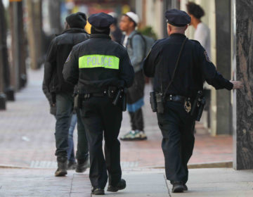 Police officers patrol Market Street in Wilmington, Del., on Thursday, March 26. (Saquan Stimpson for WHYY)