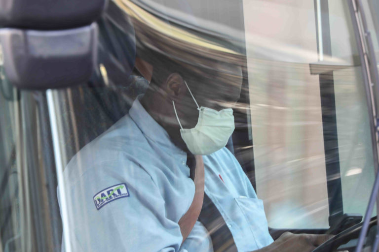 A dart bus driver wears a protective mask while waiting for passengers Friday. March 27, 2020, in Wilmington, Del. (Saquan Stimpson for WHYY)