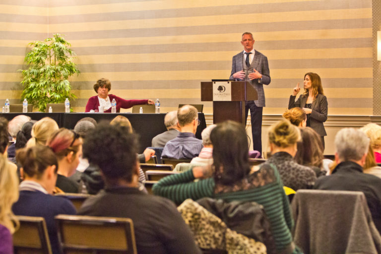 Dr. Steve Alles, director of disease control at the Philadelphia Department of Health, addresses the health care community at a COVID-19 symposium on Wednesday. (Kimberly Paynter/WHYY)