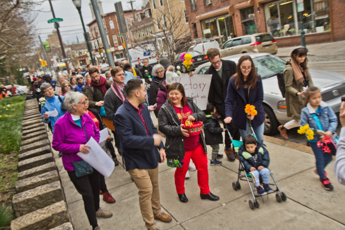 Suyapa Reyes and members of the First United congregation march to the Germantown Mennonite church where Carmela Apolonio Hernandez, another mother living in sanctuary, has called home for the past two years. (Kimberly Paynter/WHYY)