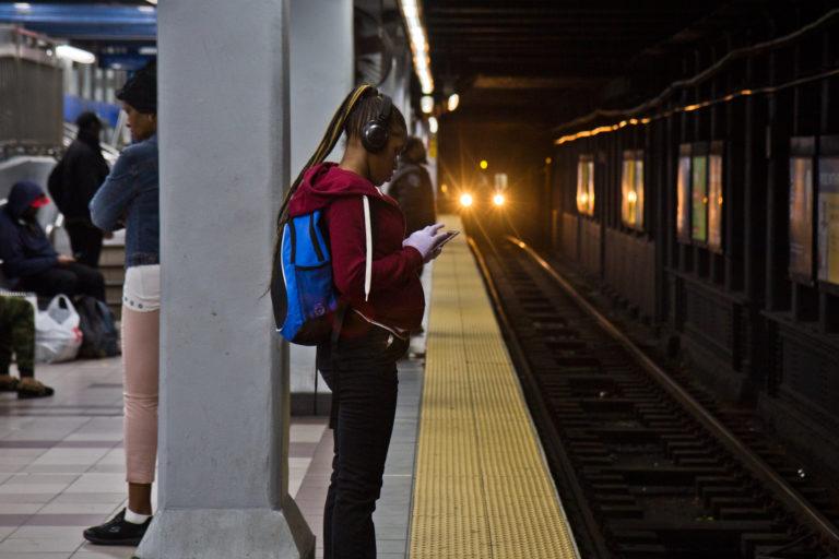 A rider waits for a SEPTA train.