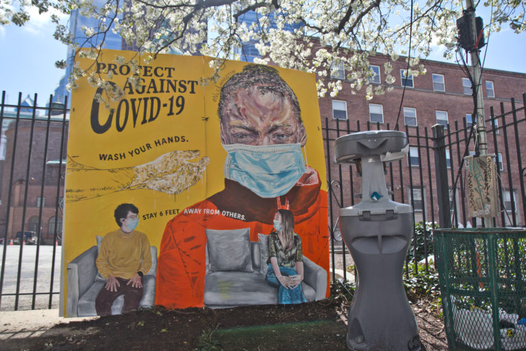 A mural created by artist Nile Livingston was installed at 17th and Vine streets along with a public hand washing station meant for people who are living with housing instability. (Kimberly Paynter/WHYY)