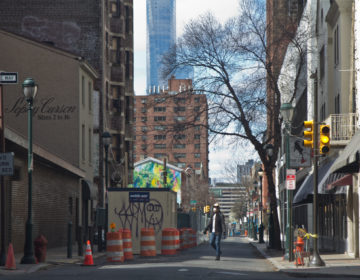 A person walks down Sansom Street in Center City Tuesday. (Kimberly Paynter/WHYY)