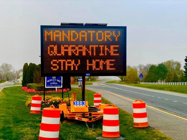 Road sign alerts drivers of mandatory quarantine. (Photo courtesy of Joy Marie)