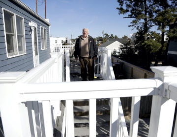 In a photo taken Friday, Jan. 11, 2019, Vince Farias poses for The Associated Press outside one of his vacation rental properties in Surf City, N.J. (Julio Cortez/AP Photo)