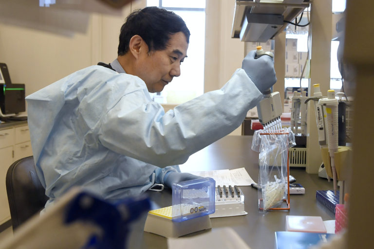 Microbiologist Xiugen Zhang runs a Polymerase Chain Reaction (PCR) test at the Connecticut State Public Health Laboratory, Monday, March 2, 2020, in Rocky Hill, Conn. (Jessica Hill/AP Photo)