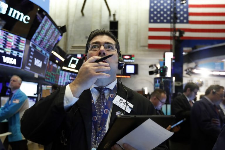 Trader Michael Capolino works on the floor of the New York Stock Exchange, Tuesday, March 3, 2020. Stocks are opening lower on Wall Street after the Group of Seven countries held off on giving the global economy new stimulus to help it cope with the coronavirus outbreak. (AP Photo/Richard Drew)