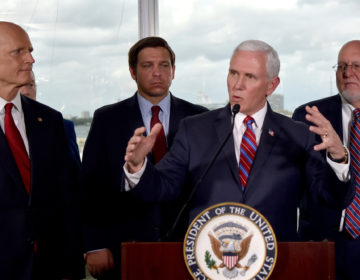 Vice President Mike Pence, center, along with Florida Senator Rick Scott, far left, and Governor Ron DeSantis,left, and CDC Director Dr.Robert Redfield,right, speaks to the media in Fort Lauderdale, Fla. (Gaston De CardenasAP Photo)