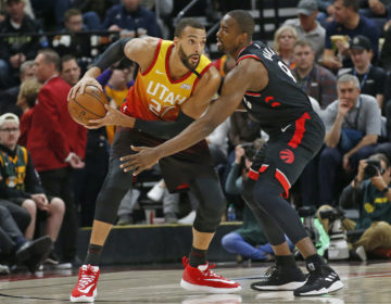 Toronto Raptors center Serge Ibaka (9) guards against Utah Jazz center Rudy Gobert (27) in the first half during an NBA basketball game Monday, March 9, 2020, in Salt Lake City. (Rick Bowmer/AP Photo)