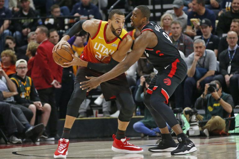 Toronto Raptors center Serge Ibaka (9) guards against Utah Jazz center Rudy Gobert (27) in the first half during an NBA basketball game Monday, March 9, 2020, in Salt Lake City. (Rick Bowmer/AP Photo)