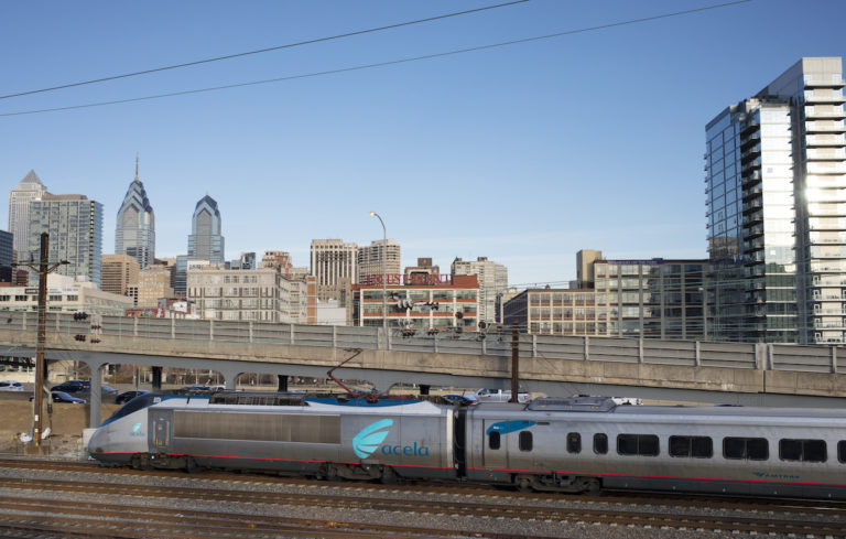Northbound Amtrak Acela nonstop Train 2402 approaches 30th Street Station, out of frame at left, Monday, March 9, 2020, in Philadelphia along the Northeast Corridor. (David Boe/AP Photo)