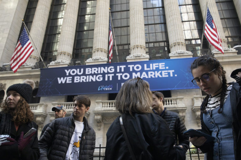 In this Monday, March 9, 2020 file photo, people stop to look at the New York Stock Exchange. Stocks are opening sharply lower on Wall Street Wednesday as fears of economic fallout from the coronavirus outbreak grip markets again.  (Mark Lennihan/AP Photo)