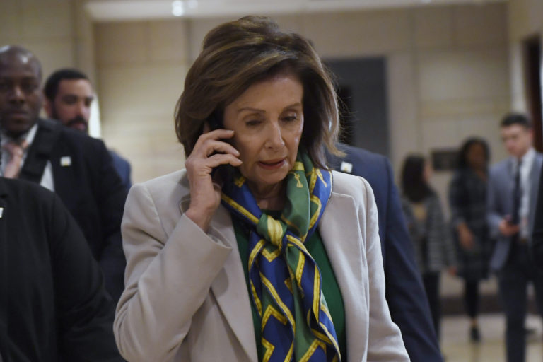 House Speaker Nancy Pelosi of Calif., walks on Capitol Hill in Washington, Thursday, March 12, 2020, as she heads to a briefing on the coronavirus. (AP Photo/Susan Walsh)