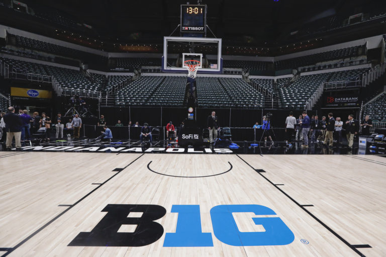 The seating area and court at Bankers Life Fieldhouse is shown in Indianapolis, Thursday, March 12, 2020, after the Big Ten Conference announced the remainder of the men's tournament is cancelled,  effective immediately. (AP Photo/Michael Conroy)