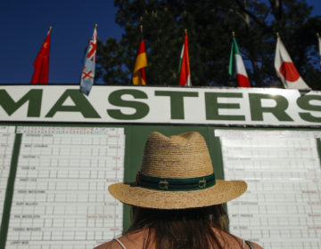 Anna Lee Lavarnway looks at the leaderboard during the first round at the Masters golf tournament Thursday, April 5, 2018, in Augusta, Ga. (Charlie Riedel/AP Photo)