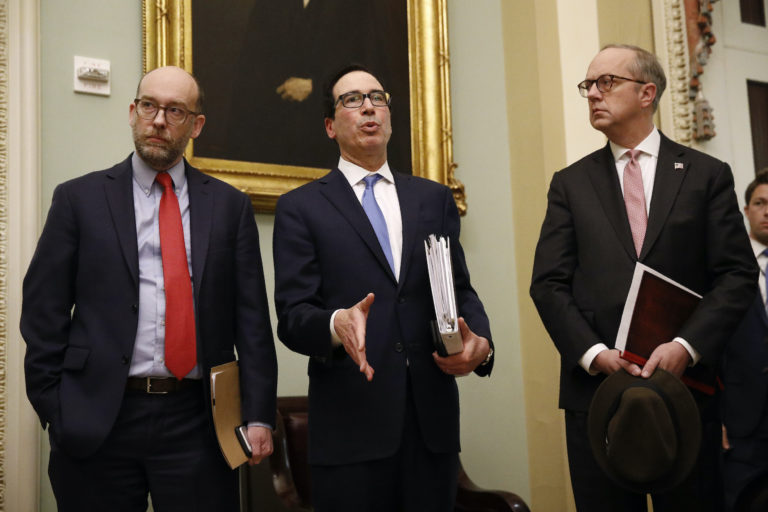 Treasury Secretary Steve Mnuchin, center, speaks with members of the media as he departs a meeting with Senate Republicans on an economic lifeline for Americans affected by the coronavirus outbreak. on Capitol Hill in Washington, Monday, March 16, 2020. (Patrick Semansky/AP Photo)