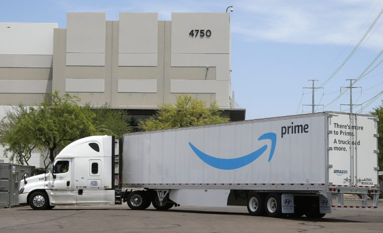 This July 17, 2019, file photo shows an Amazon shipping truck at a fulfillment center in Phoenix. (Ross D. Franklin/AP Photo)