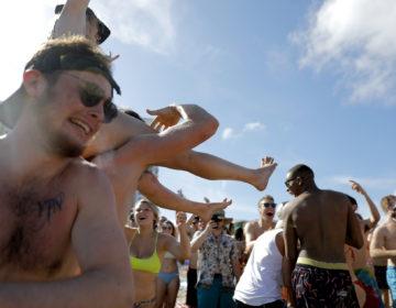 Spring break revelers party on the beach, Tuesday, March 17, 2020, in Pompano Beach, Fla. (Julio Cortez/AP Photo)