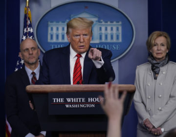 President Donald Trump takes questions during press briefing with the coronavirus task force, at the White House, Thursday, March 19, 2020, in Washington. Food and Drug Administration Commissioner Dr. Stephen Hahn, at left, and Dr. Deborah Birx, White House coronavirus response coordinator, at right listen. (AP Photo/Evan Vucci)