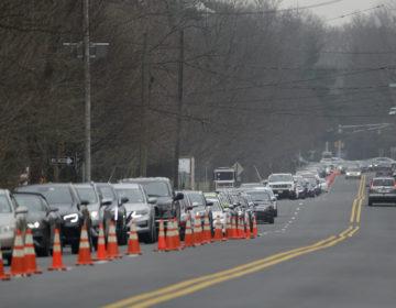 A long line of cars waits to enter a drive-through COVID-19 coronavirus testing center in Paramus, N.J., Friday, March 20, 2020. (Seth Wenig/AP Photo)