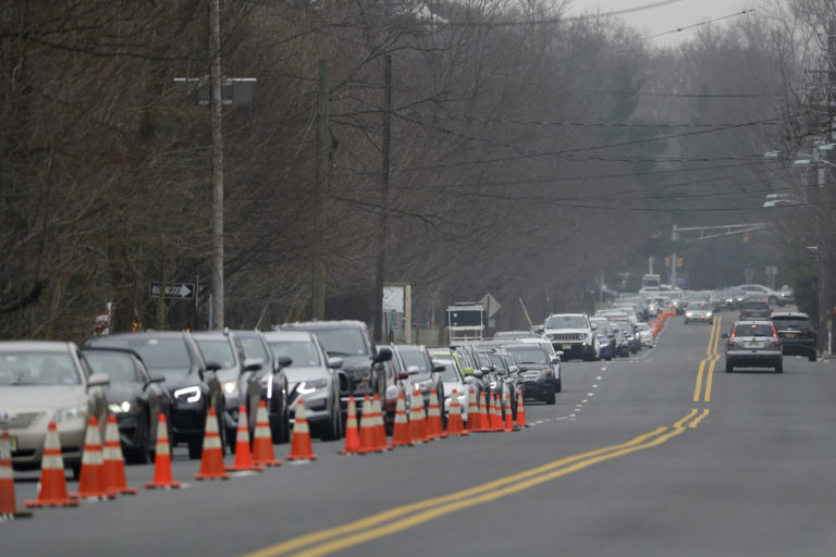 A long line of cars waits to enter a drive-through COVID-19 coronavirus testing center in Paramus, N.J., Friday, March 20, 2020. (Seth Wenig/AP Photo)