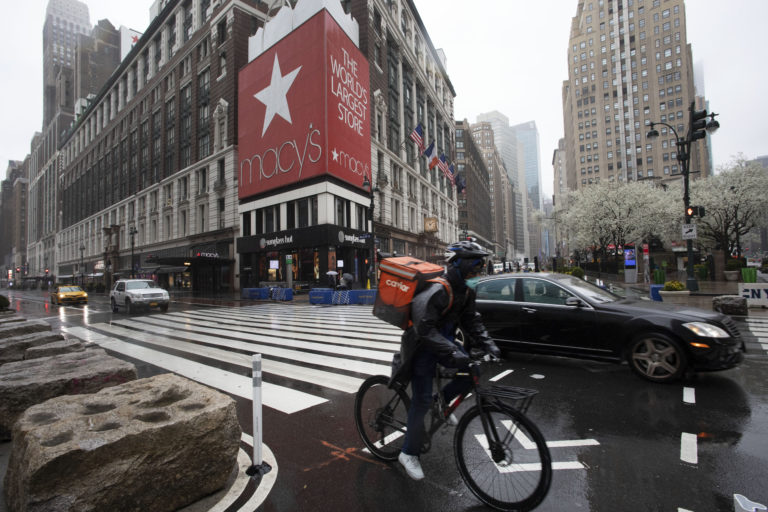 A cyclist passes Macy's in Herald Square, Monday, March 23, 2020, in New York. Macy's stores nationwide are closed due to the coronavirus. (Mark Lennihan/AP Photo)