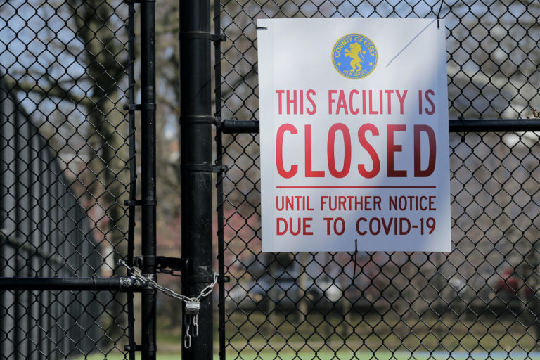 A sign is displayed on locked tennis courts in Branch Brook Park in Newark, N.J., Thursday, March 26, 2020. (Seth Wenig/AP Photo)