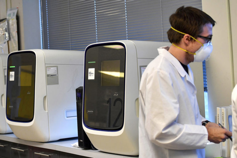 Molecular technologists work next to QuantStudio 12K Flex Real Time PCR machines that test for COVID-19 at MHS Labs, Friday, March 27, 2020, in Monroeville, Pa. (Matt Freed/Pittsburgh Post-Gazette via AP)