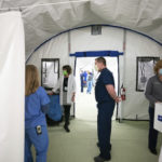 Medical staff inside the new emergency response tent during a media tour of the facility at Doylestown hospital, in Doylestown, Pa., Monday, March 30, 2020. the emergency response tent will centralize diagnosis and initial treatment for those with respiratory symptoms suggesting COVID-19. (Jessica Griffin/The Philadelphia Inquirer via AP)