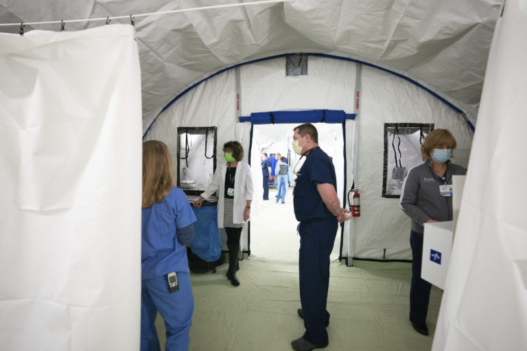Medical staff inside the new emergency response tent during a media tour of the facility at Doylestown Hospital, in Doylestown, Pa., Monday, March 30, 2020. (Jessica Griffin/The Philadelphia Inquirer via AP)