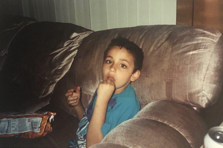 Pulse Reporter Jad Sleiman eating chips, watching traffic around age 3 (Image courtesy of Ghada Suleiman)
