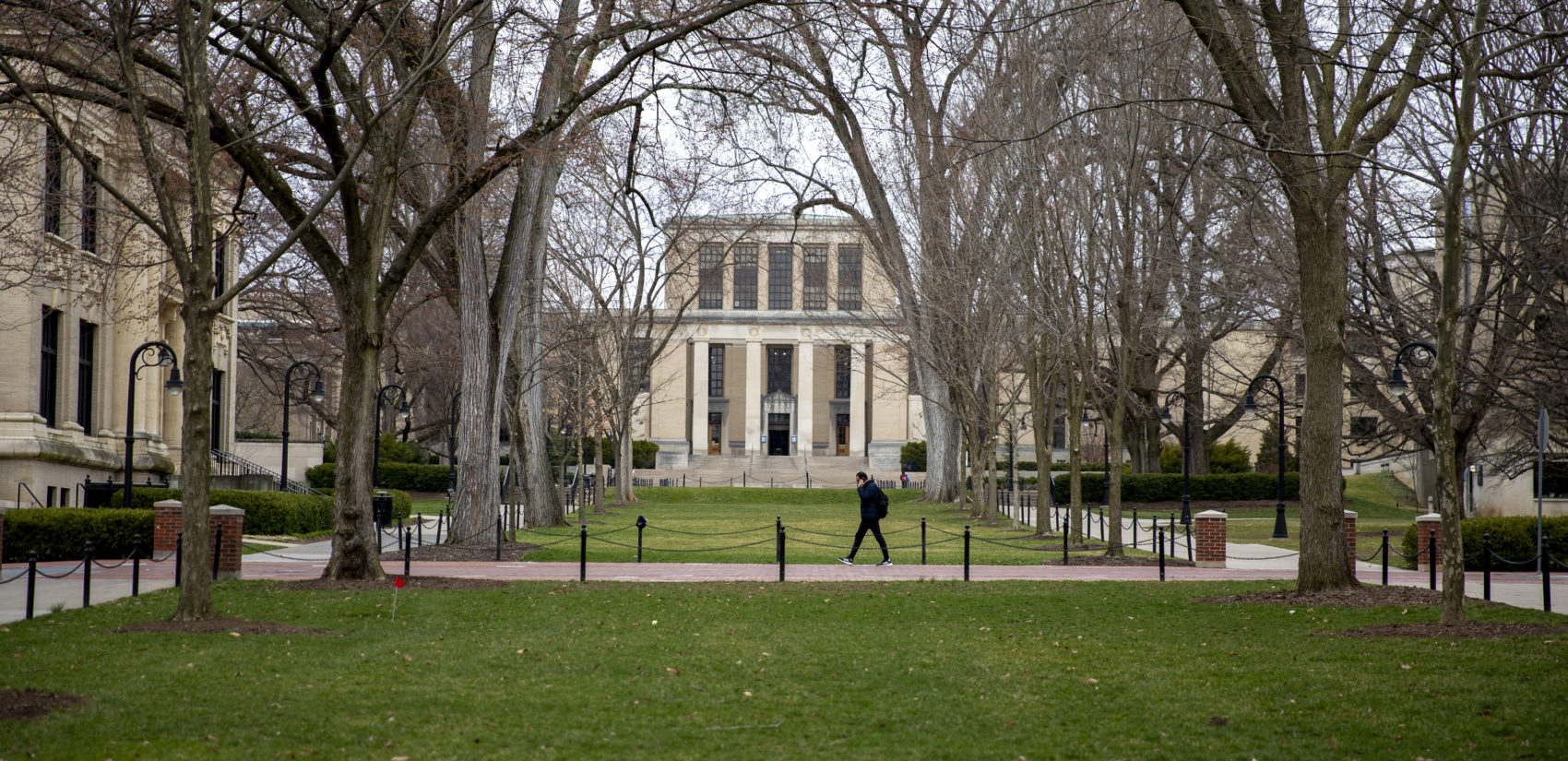 A student walks alone at Penn State's University Park campus, where coronavirus has suspended in-person classes. (Min Xian / WPSU)