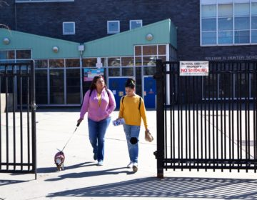 Xiomara Diaz and her daughter Genesis Diaz leave William Hunter School in Kensington with free meals because of the coronavirus shutdown. (Kimberly Paynter/WHYY)