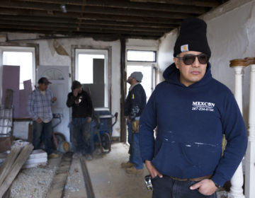 Javier Garcia Hernandez, a project manager with the Philadelphia construction cooperative MexCon, inspects a job site on Jan. 10, 2020. (Rachel Wisniewski / For WHYY)