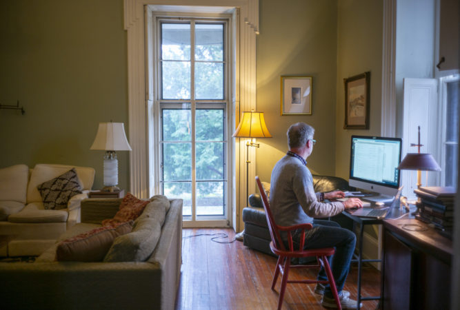 Michael Prell, who works in IT, working from home in his living room (Jessica Kourkounis for Keystone Crossroads)