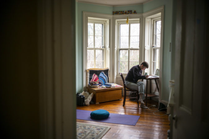 Michaela Prell, Riley's sister, is a senior at Sarah Lawrence College. She set up a make-shift desk in her old bedroom since school shut down. (Jessica Kourkounis for Keystone Crossroads)
