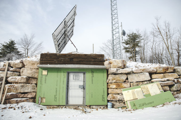 The set up on Stone Mountain consists of a radio tower, solar panels and an equipment room and is key to how the Rural Broadband Cooperative is delivering broadband internet to its users. (Min Xian/Keystone Crossroads)