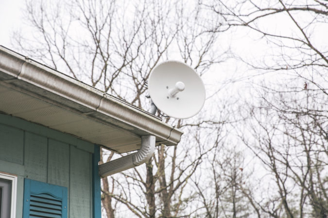 The radio receiver at Ken Diven's home aims at the Stone Mountain radio tower. A signifiant limit in fixed wireless broadband connection is that it requires a direct line of sight. (Min Xian/Keystone Crossroads)