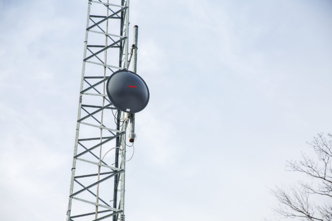This specific receiver mounted on the radio tower points at another radio dish at Allensville, where a nearby fibre optic network turns into radio signal. (Min Xian/Keystone Crossroads)