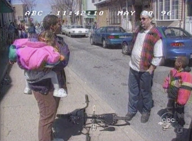 Bridesburg residents talking in the street amid a media circus during Nightline's 1996 feature. (Vanderbuilt Television News Archive)