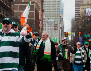 State Supreme Court Justice Kevin Dougherty marched with Electricians Local Union 98 during the 2017 Saint Patrick's Day Parade, in Philadelphia. (Brad Larrison for WHYY)