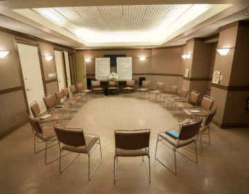 12 step recovery meeting room with chairs and signs. (Bigstock/blueskies9)