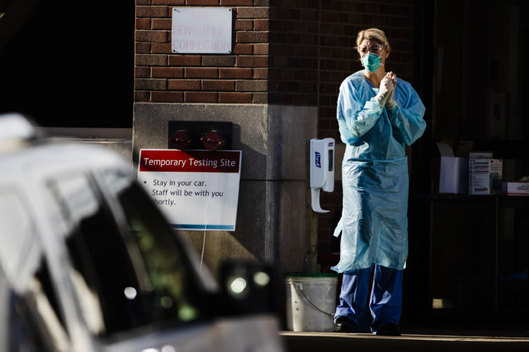 A health care worker stands by at a COVID-19 temporary testing site at Abington Hospital in Abington, Pa., Wednesday, March 18, 2020. (Matt Rourke/AP Photo)