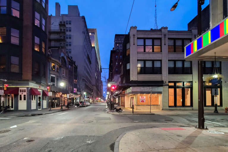 The intersection of 13th and Sansom streets is empty on a recent evening. (Danya Henninger/Billy Penn)